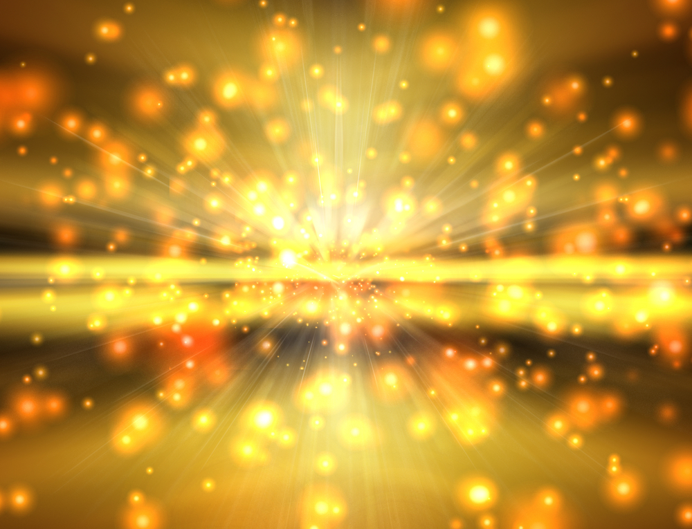 Abstract picture of bright yellow particles in motion